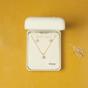 Set of 10kt gold Swarovski necklace and earrings